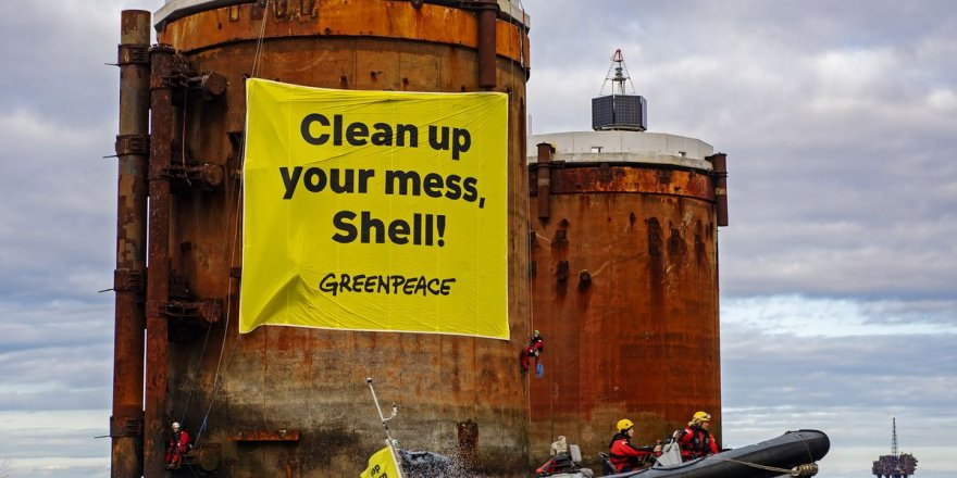 "Greenpeace activists protest ""hazardous oily sludge"" in North Sea"
